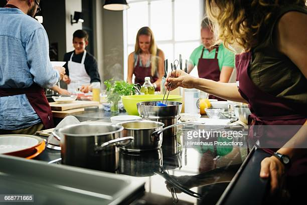 Woman stiring a choclat sauce in a cooking class