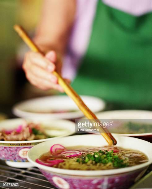 Woman stirring soup