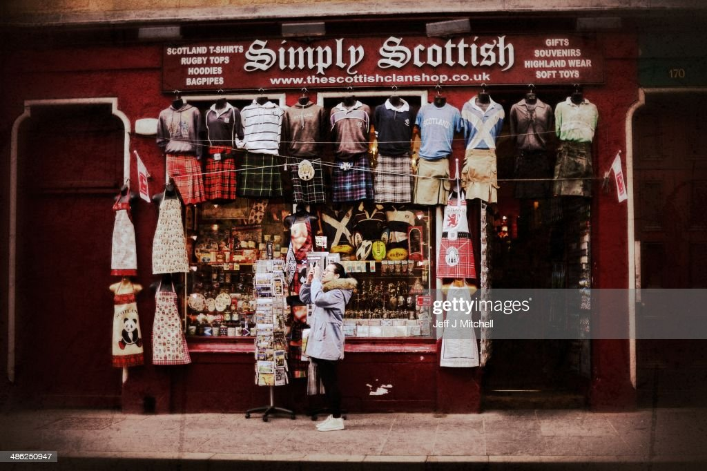 A woman stops to take a photograph outside a shop on the Royal Mile on April 23, 2014 in Edinburgh, Scotland. A referendum on whether Scotland should be an independent country will take place on September 18, 2014.