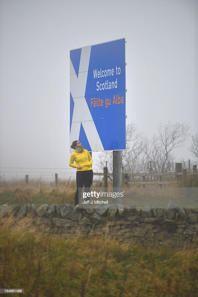 A woman stops to take pictures at Carter Bar view point where the A68 crosses from Scotland into England on October 22, 2012 in Carter Bar, Scotland. Last week Scottish First Minister Alex Salmond met with British Prime Minister David Cameron and agreed on details for a Scottish independence referendum to be held in the autumn of 2014 asking a single yes or no question on whether the country should become independent.