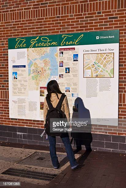 A woman stops to view the Freedom Trail map in the North End on November 4 2012 in Boston Massachusetts Despite a global recession that has lasted...