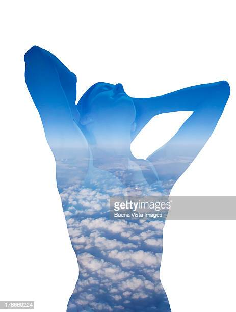 woman stretching among clouds
