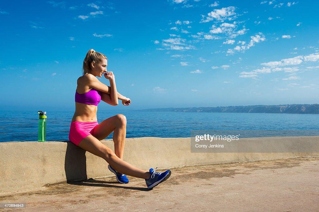 Woman stretching at coast