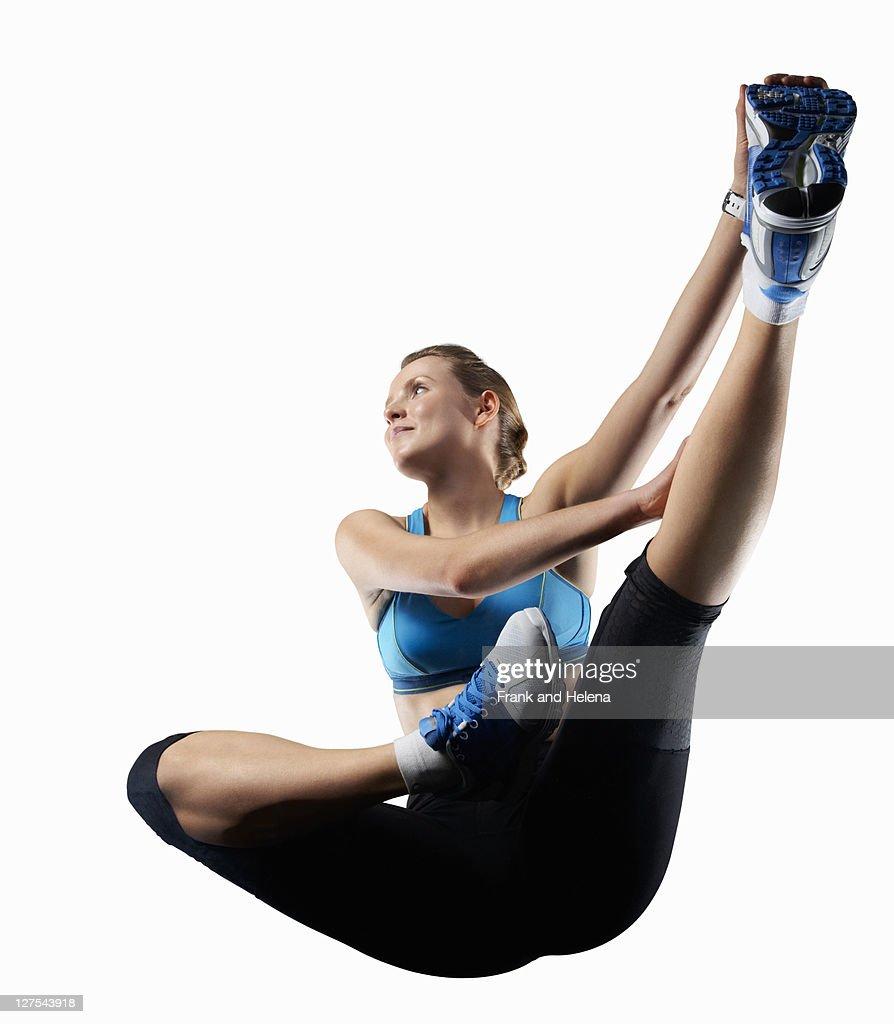 Woman stretching before exercise : Stock Photo