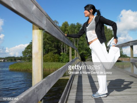 Woman stretching before jogging : Stock Photo