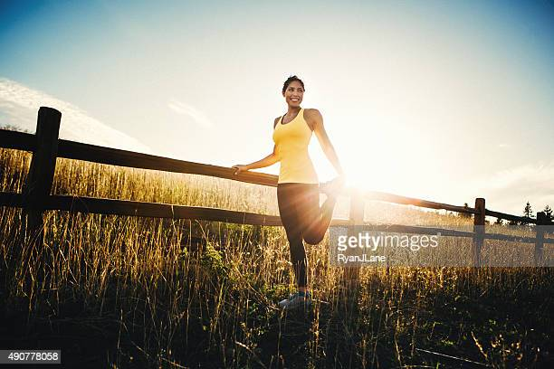 Woman Stretching Before Run in Beautiful Nature Setting