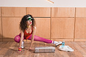 beautiful woman in stylish body suit stretching before training