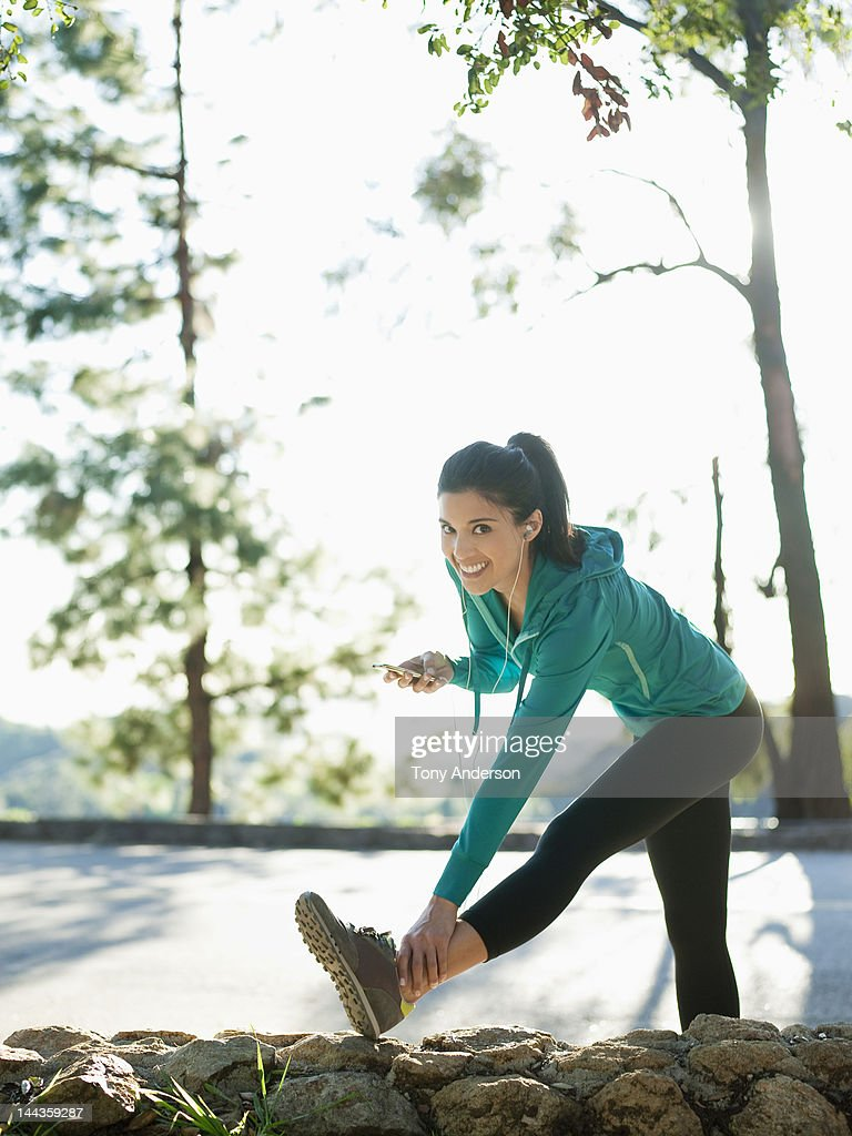 Woman stretching for workout : Stock Photo