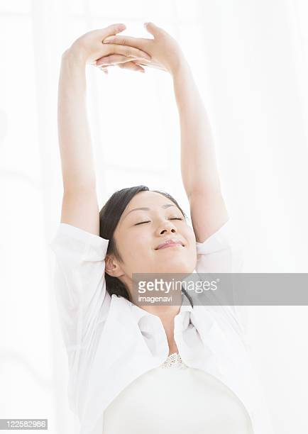 Woman stretching her arms
