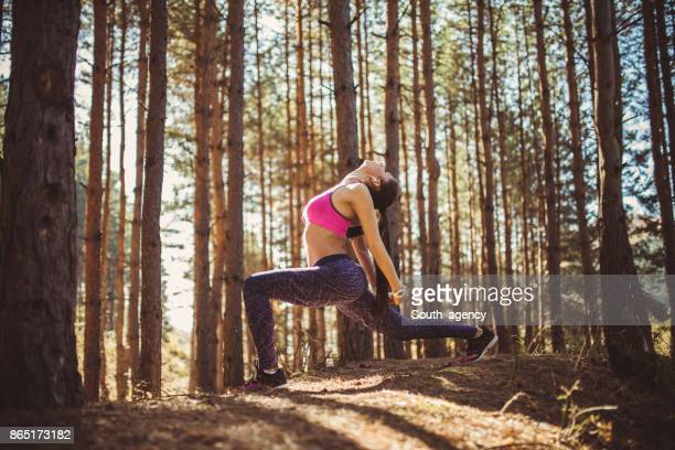 Woman stretching in forest