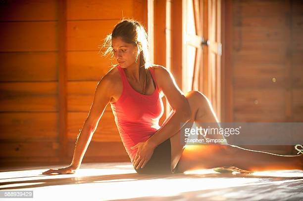 woman stretching in slanting light