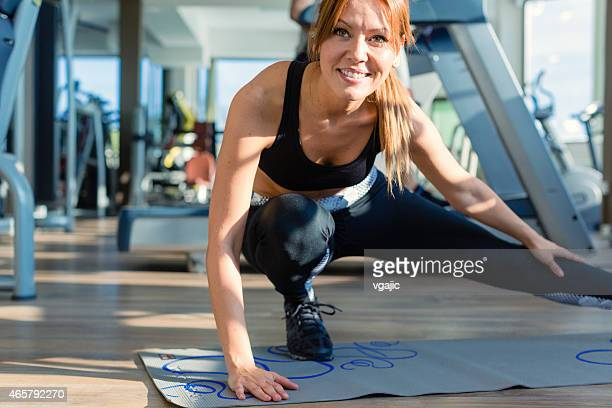 Woman stretching in the gym.