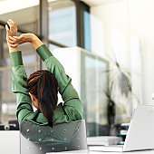 woman stretching in the office