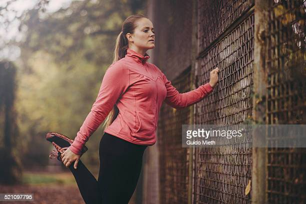 Woman stretching leg after running.