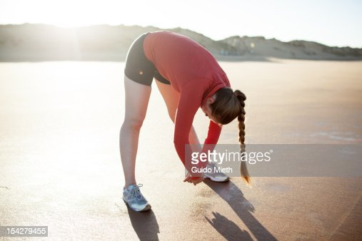 Woman stretching on a beach. : Stock Photo