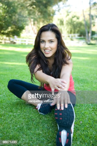 Woman stretching on grass : Stock-Foto