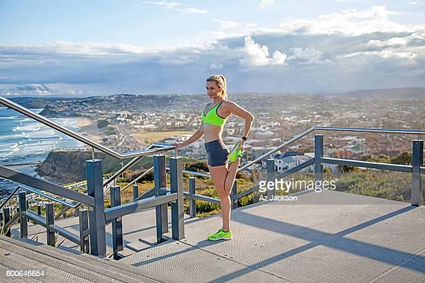 Woman stretching on the Anzac Bridge walkway