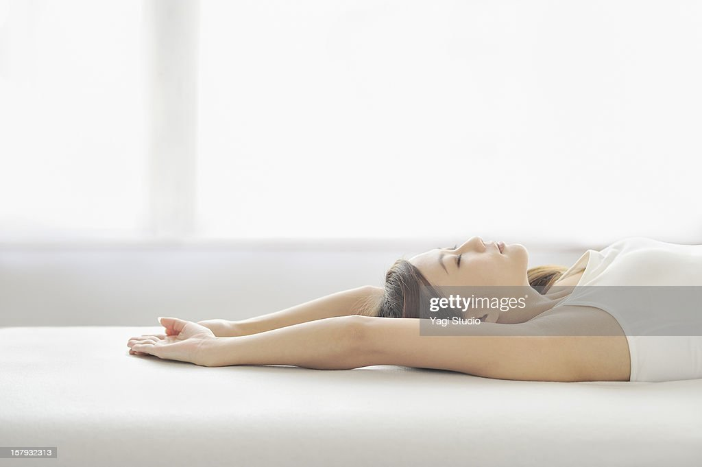 Woman stretching on the bed