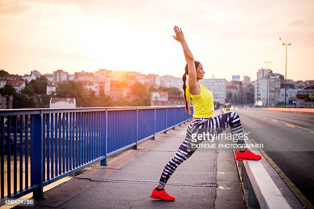Woman stretching on the bridge