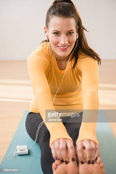 Woman stretching with mp3 player