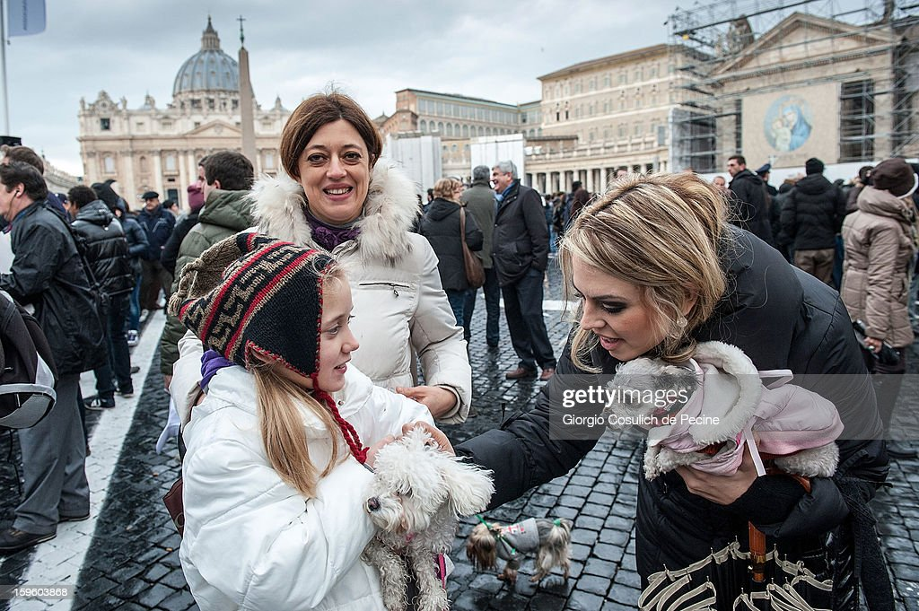 A woman strokes a dog in front of the Saint Peter Basilica, during a traditional day of blessing of the animals, on January 17, 2013 in Vatican City, Vatican. Every year, during the feast of St. Anthony the Abbot, the traditional blessing of the animals is celebrated.