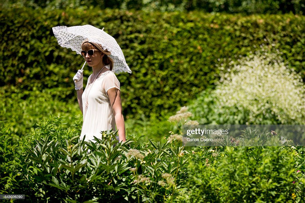 TORONTO, ON - JUNE A woman strolls through the garden. Gatsby Garden Party is a revival event at the Spadina Museum based on Scott Fitzgeralds novel The Great Gatsby with music, food and drinks from the roaring 1920s. Over the soft, sweet tones of cool jazz, guests participate in a costume contest, or play a game of croquet.June 25, 2016.