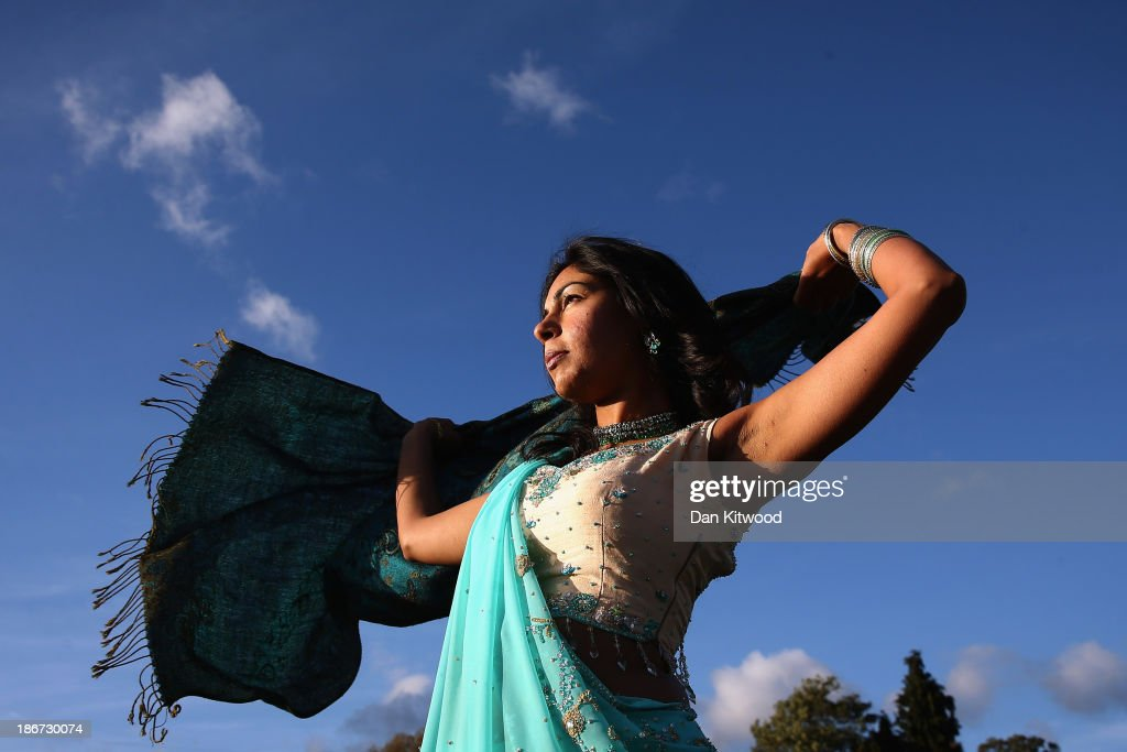 A woman struggles with her scarf in high winds during Diwali celebrations at Bhaktivedanta Manor on November 3, 2013 in Watford, United Kingdom. The festival is an opportunity for Hindus to honour Lakshmi, the goddess of wealth and other gods. Leicester's celebrations are one of the biggest in the world outside India.