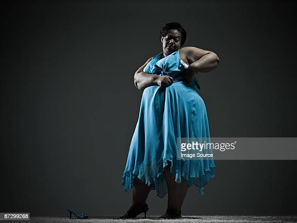 Woman struggling with dress