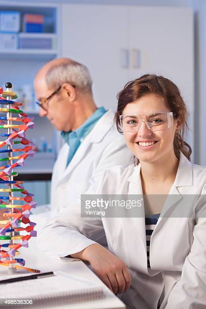 Woman Student with Teacher in Chemistry Laboratory