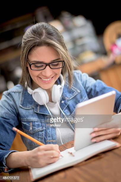 Woman studying at a coffee shop