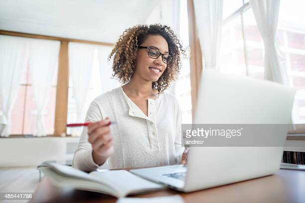 Woman studying online at home