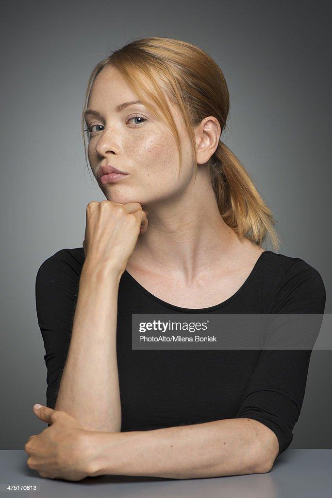 Woman sulking, portrait