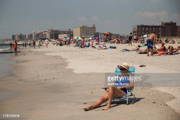 A woman sunbathes at Rockaway Beach during a heat wave on July 17 2013 in the Rockaway Beach neighborhood of the Queens borough of New York City...