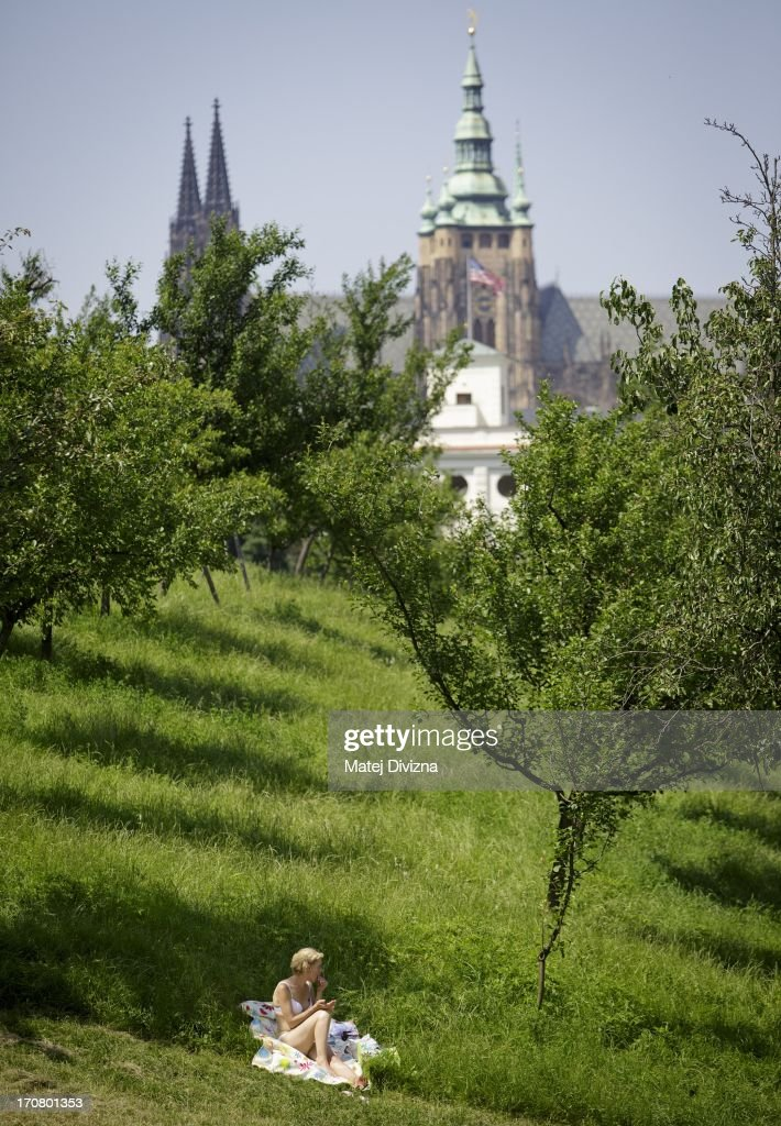 A woman sunbathes during the hot and sunny day on the Petrin Hill on June 18, 2013 in Prague, Czech Republic. As a heat wave hits the central Europe region, the Karlov district of Prague enjoyed a record breaking temperature of 37 degree Celsius.