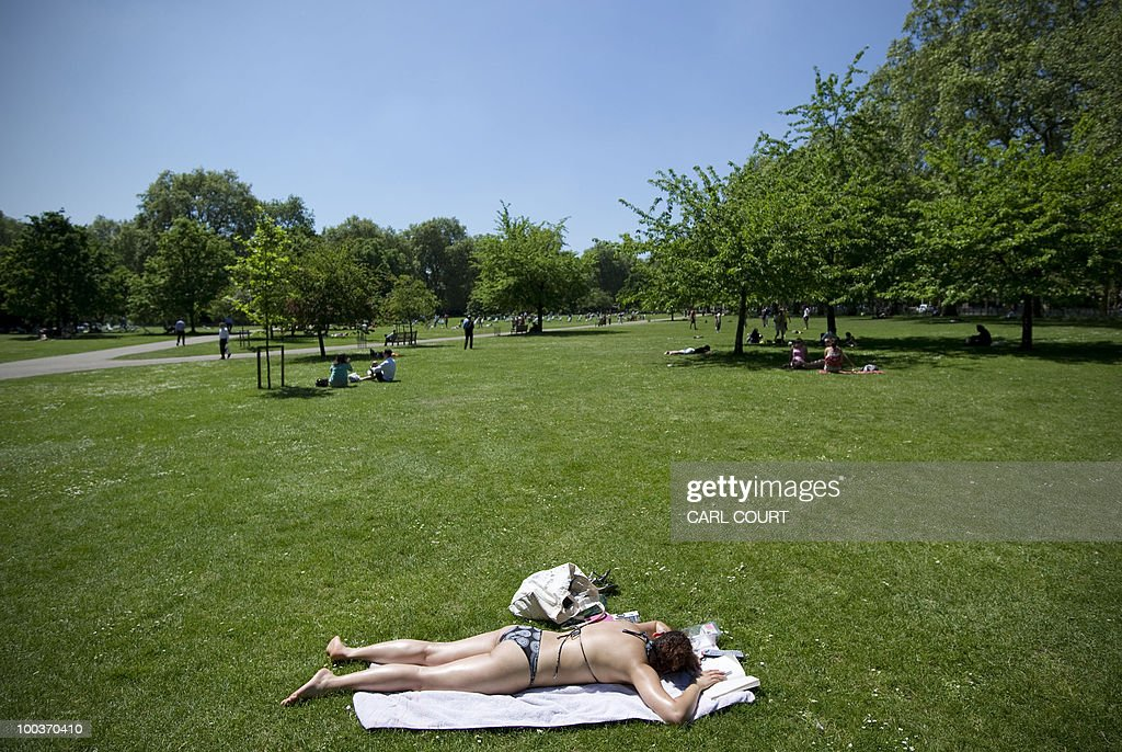 A woman sunbathes in St James' Park in London, on May 24, 2010. A mini-heatwave over the last few days has seen UK temperatures outstrip many European holiday destinations such as Rome and Rhodes. AFP PHOTO/Carl Court