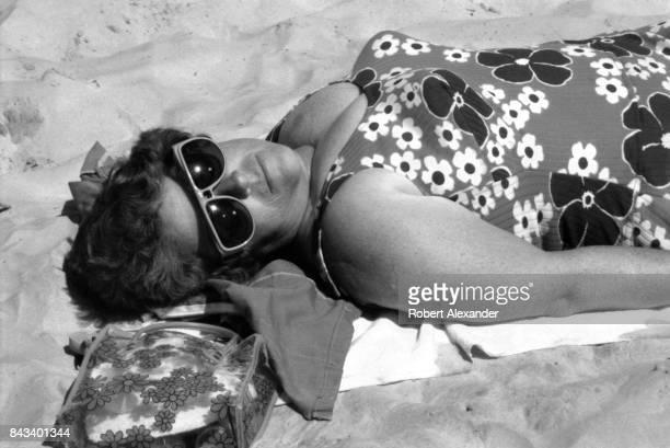 A woman sunbathes on the beach in Daytona Beach Florida in 1983