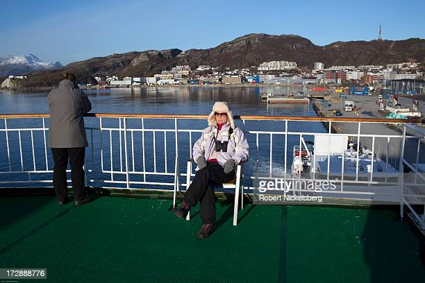A woman sunbathes on the rear deck March 1 2013 of the Norwegian passenger and freight boat Hurtigruten ijn Bodo Norway The ship will travel the...