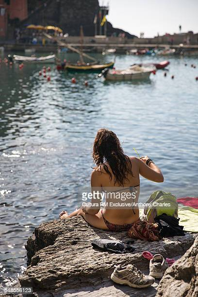 Woman sunbathing and relaxing, Vernazza, Cinque Terre, Italy