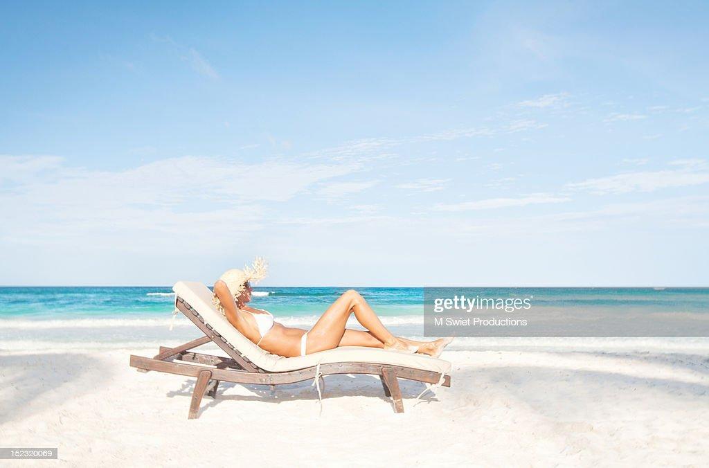 Woman sunbathing beach : Stock Photo