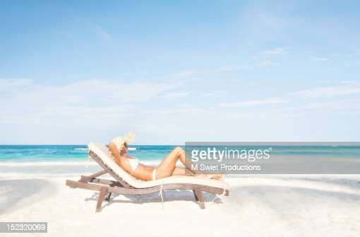 Woman sunbathing beach : Photo