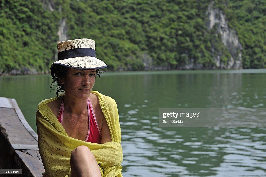 Woman sunbathing by Halong Bay : Stock Photo
