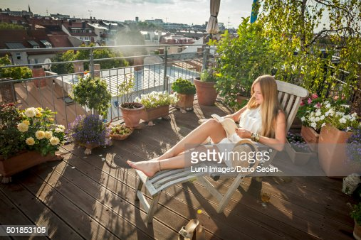 Woman sunbathing on balcony munich bavaria germany europe for Balcony sunbathing