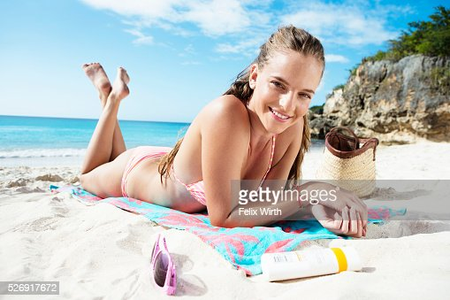 Woman sunbathing on beach : Stock Photo