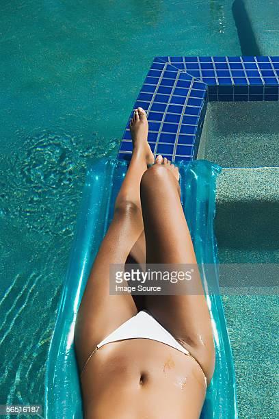 Woman sunbathing poolside
