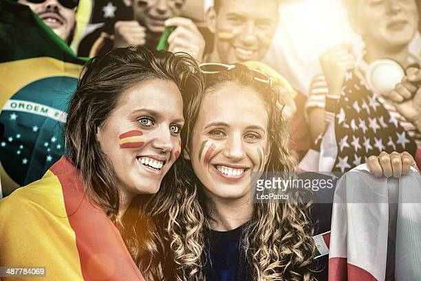 Woman supporters of different teams at the stadium