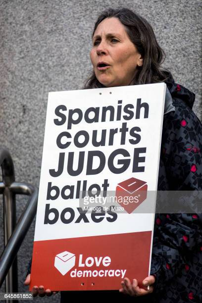 A woman supporting Francesc Homs as he goes to declare for allowing ballots for an independence referendum in Catalonia