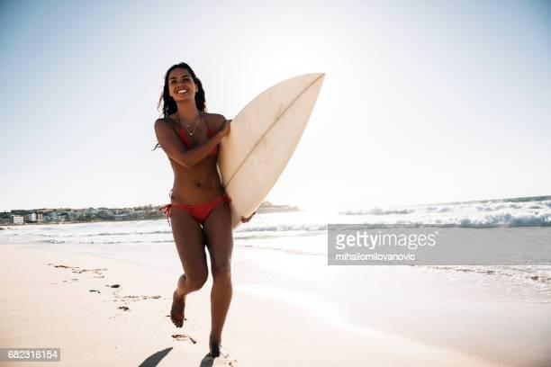 Woman surfer running