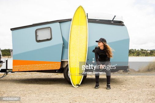 Woman surfing in a wetsuit. : Stock Photo