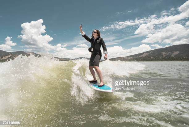 Woman Surfing in Dry Business Attire while taking a Selfie