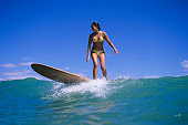 Woman surfing in sea, low angle view